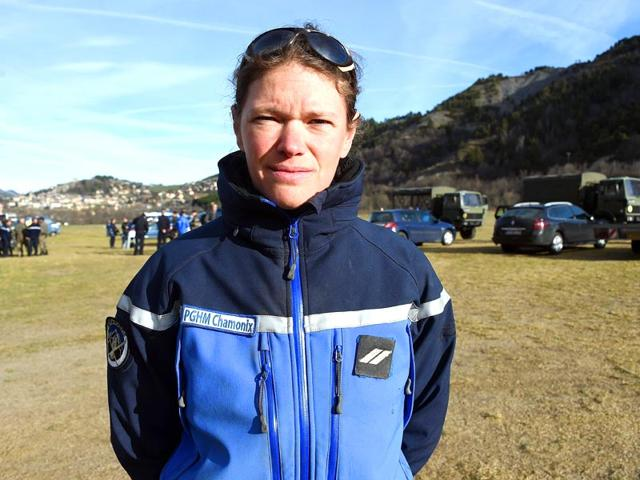 Alice-Coldefy-centre-a-French-gendarme-from-the-PGHM-Gendarmerie-High-Mountain-Rescue-Squad-speaks-with-gendarmes-in-Seyne-Les-Alpes-near-the-crash-site-of-the-German-Airbus-A320-of-the-low-cost-carrier-Germanwings-AFP-Photo