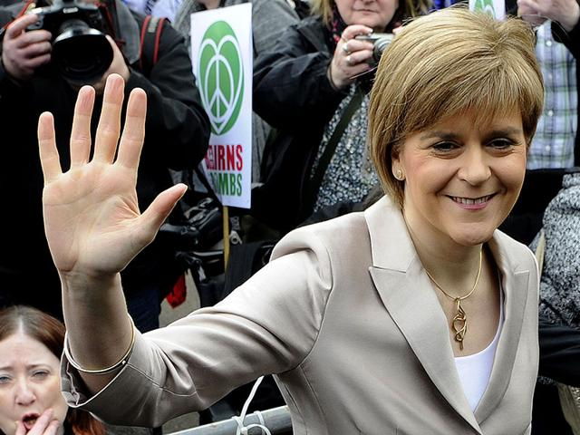 Scotland-s-First-Minister-and-leader-of-the-Scottish-National-Party-SNP-Nicola-Sturgeon-waves-as-she-joins-a-rally-against-the-Trident-nuclear-programme-AFP-Photo