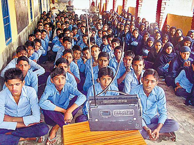 Children-at-a-government-school-in-Mewat-district-of-Haryana-listen-to-Mewat-Radio-a-small-budget-station-exclusive-to-the-area-HT-Photo
