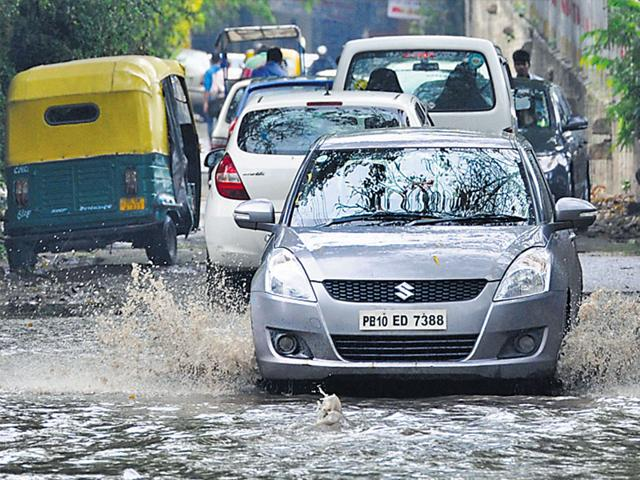 Vehicles-make-their-way-through-a-waterlogged-road-in-Jangpura-area-of-the-Capital-on-Saturday-morning-Saumya-Khandelwal-HT-Photo