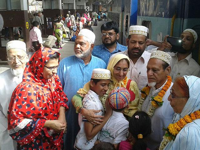 Nazar-Hussein-Munim-and-his-family-members-are-greeted-by-relatives-at-the-Indore-railway-station-after-their-arrival-from-Yemen-Shankar-Mourya-HT-Photo