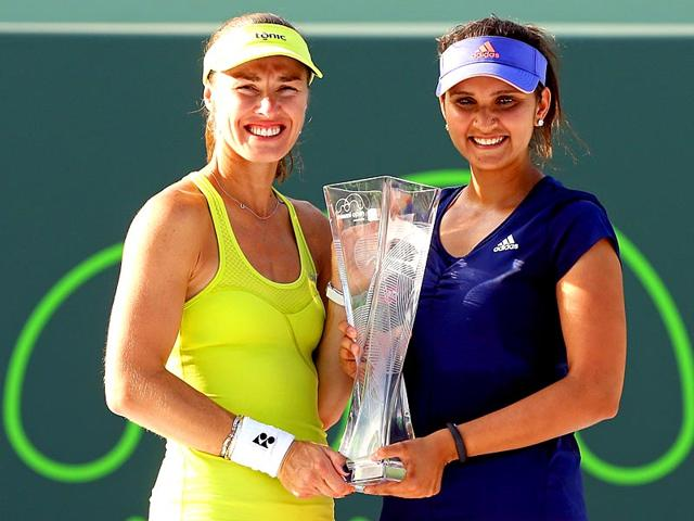 In-this-file-photo-Martina-Hingis-and-Sania-Mirza-pose-with-the-Butch-Buchholz-Trophy-The-duo-won-outplayed-Germany-s-Julia-G-rges-and-Czech-Republic-s-Barbora-Krejc-kov-6-3-6-0-to-enter-the-second-round-of-the-2015-French-Open-in-Paris-AFP-Photo