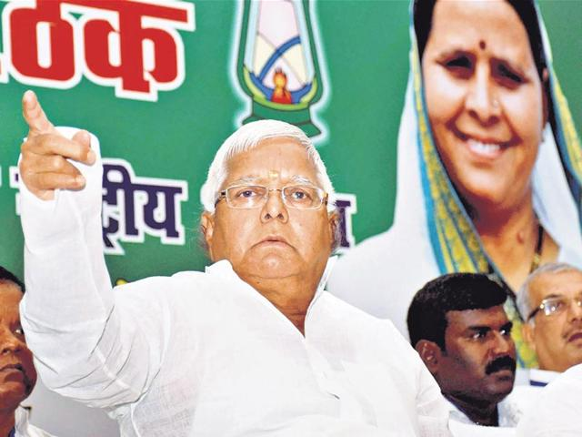 RJD chief Lalu Prasad at his residence in Patna. 25-years since the Mandal wave which made his political fortunes,Lalu Prasad is attempting to re-create a caste wave this Bihar election to be on the winning side and to bequeath his sons a durable political legacy. (HT Photo)