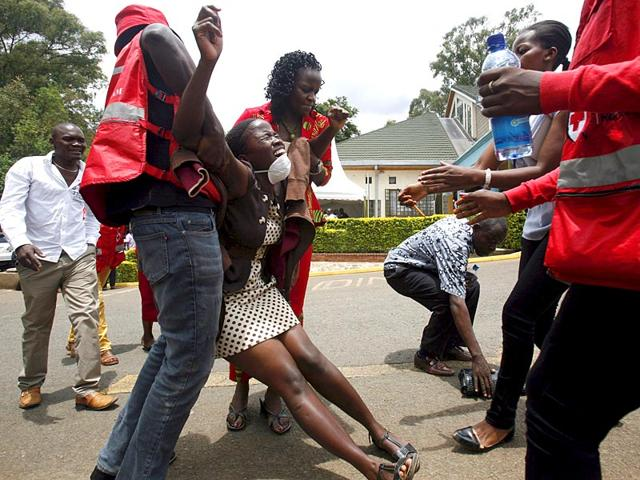 A-relative-is-assisted-by-Kenya-Red-Cross-staff-as-she-reacts-where-bodies-of-the-students-killed-in-Thursday-s-attack-by-gunmen-are-preserved-at-the-Chiromo-Mortuary-in-the-capital-Nairobi-Reuters