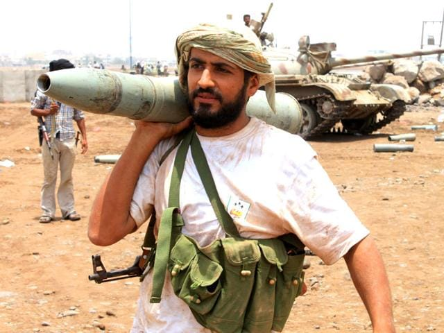 A-Yemeni-supporter-of-the-separatist-Southern-Movement-rests-a-tank-shell-on-his-shoulder-in-the-city-of-Aden-AFP-Photo