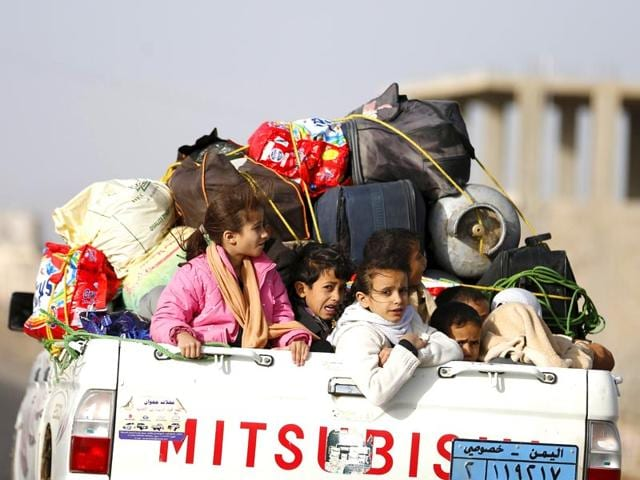 Children-ride-on-the-back-of-a-pick-up-truck-with-their-luggage-as-they-flee-Saudi-led-air-strikes-in-Sanaa-April-6-2015-REUTERS-Photo