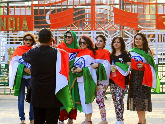 Draped-in-the-national-flag-tourists-posing-for-photographs-at-the-Attari-border-in-Amritsar-HT-Photo