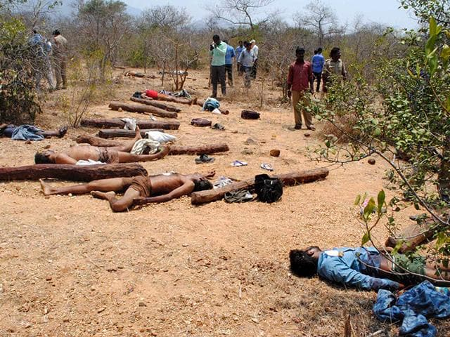 The-bodies-of-suspected-sandalwood-smugglers-who-were-killed-in-an-encounter-with-a-joint-team-of-special-police-and-forest-personnel-lie-in-the-Seshachalam-forest-of-Chittoor-district-in-Andhra-Pradesh-on-April-7-2015-AFP-Photo