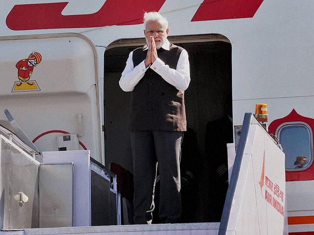 Prime-Minister-Narendra-Modi-gestures-before-his-departure-from-New-Delhi-on-Thursday-for-the-three-nation-tour-PTI-Photo