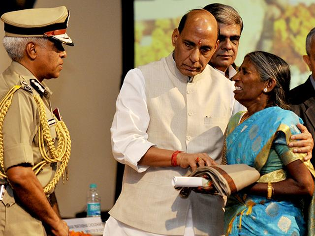 Home-minister-Rajnath-Singh-presents-a-medal-to-family-member-of-CRPF-personnel-at-the-CRPF-Valour-Day-ceremony-in-New-Delh-on-Thursday-Vipin-Kumar-HT-Photo