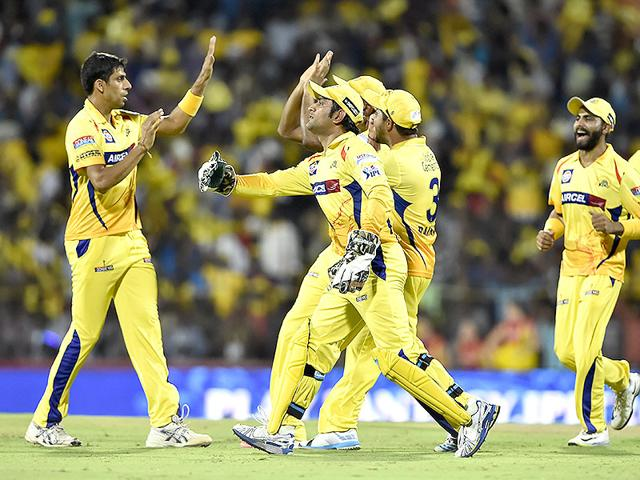 Chennai-Super-Kings-seamer-Ashish-Nehra-celebrates-with-MS-Dhoni-and-other-teammates-after-taking-the-wicket-of-a-Delhi-Daredevils-batsman-during-the-IPL-2015-match-between-the-two-sides-at-MA-Chidambaram-Stadium-in-Chennai-Mohd-Zakir-HT-Photo