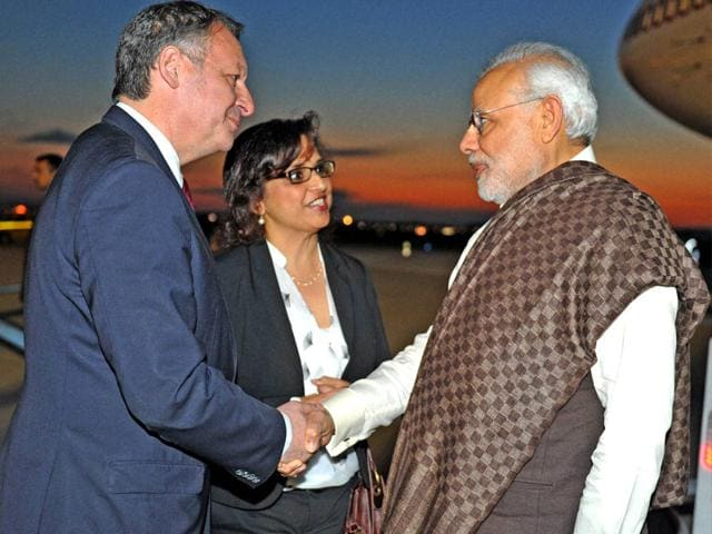 Indian-Prime-Minister-Narendra-Modi-is-greeted-by-French-employers-association-Medef-head-Pierre-Gattaz-C-and-French-Foreign-Minister-Laurent-Fabius-R-at-the-Medef-headquarters-in-Paris-AFP-Photo