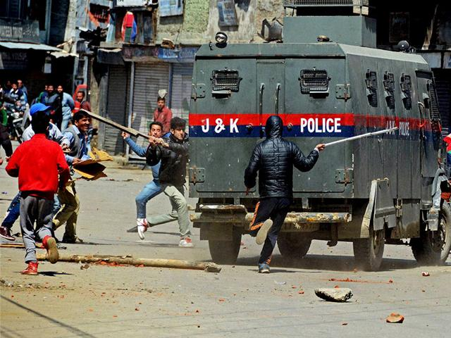 Protesters-vandalise-a-police-vehicle-during-a-protest-against-government-s-plan-for-setting-up-separate-township-for-Kashmiri-Pandits-at-Lal-Chowk-in-Srinagar-on-Friday-PTI-Photo