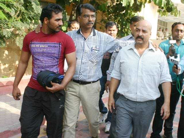 Real-estate-developer-Raja-Tomar-alias-Santosh-Singh-Tomar-right-in-white-shirt-and-Mohit-Sharma-were-arrested-by-STF-in-connection-with-forest-guard-recruitment-scam-2013-in-Bhopal-on-Friday-Bidesh-Manna-HT-photo