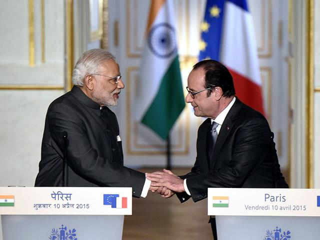 French-President-Francois-Hollande-shakes-hands-with-Indian-Prime-Minister-Narendra-Modi-after-a-joint-statement-in-Paris-AFP-Photo