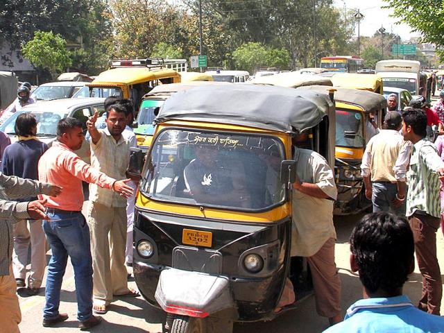 Three-wheeler-union-members-asking-auto-drivers-to-join-the-protest-near-Bharat-Nagar-Chowk-JS-Grewal-HT-Photo