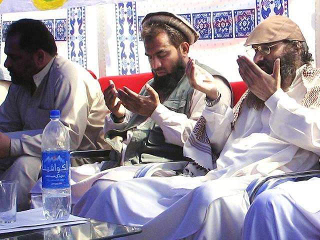In-this-June-28-2008-file-photo-suspected-Pakistani-mastermind-of-the-2008-Mumbai-attacks-Zaki-ur-Rehman-Lakhvi-prays-with-Syed-Salahuddin-chief-of-Hezbul-Mujahideen-or-United-Jehad-Council-at-a-rally-in-Muzaffarabad-in-Pak-occupied-Kashmir-AP-Photo