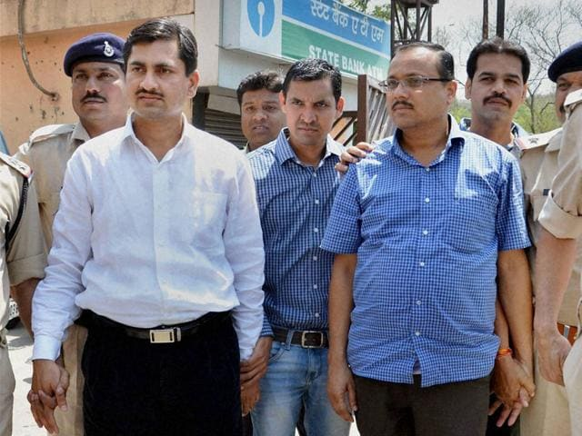Former-secretary-Satyanarayan-left-and-former-deputy-secretary-Kamlakant-Sharma-involved-in-fake-appointments-in-the-assembly-secretariat-being-produced-in-a-court-in-Bhopal-on-Friday-PTI-photo