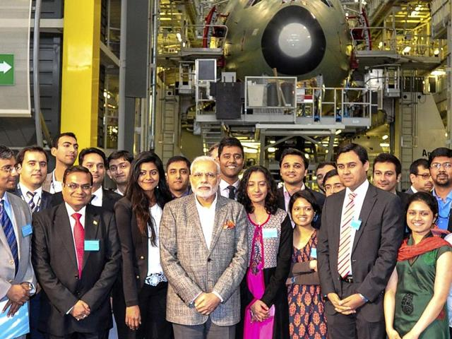Prime-Minister-Narendra-Modi-poses-with-Indian-students-during-a-visit-at-the-Airbus-headquarters-in-Toulouse-April-11-2015-Modi-is-on-a-two-day-state-visit-in-France-during-which-he-meets-the-French-President-at-the-Elysee-Palace-before-touring-the-Airbus-facilities-in-Toulouse-Reuters-Photo
