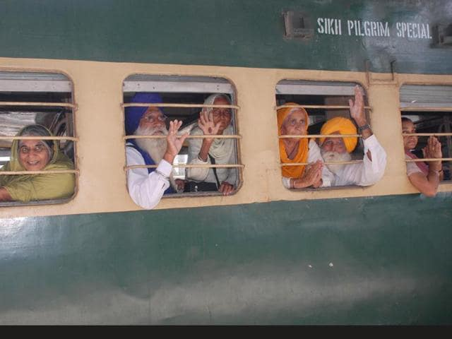 The-Sikh-pilgrims-waves-from-the-window-of-special-Pakistani-train-as-they-leaving-for-Lahore-to-celebrate-Baisakhi-festival-in-Pakistan-from-Amritsar-railway-station-Sameer-Sehgal-HT