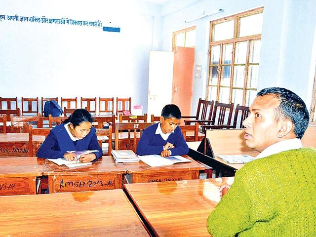 Two-students-attend-a-class-at-the-school-HT-Photo