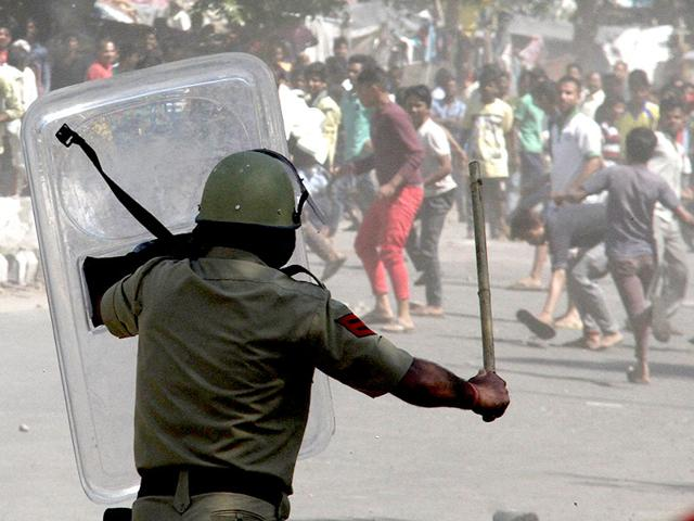 A-policeman-warding-off-the-protesters-at-Colony-number-4-Industrial-Area-Phase-1-in-Chandiagrh-on-Saturday-Karun-Sharma-HT-Photo