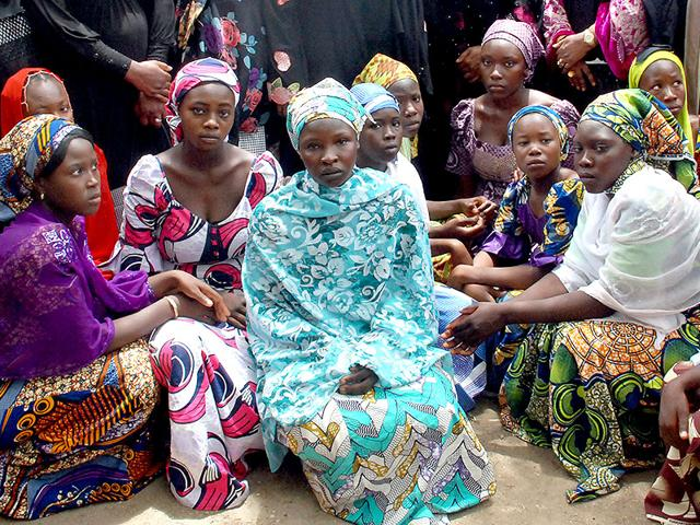 A-file-picture-taken-on-May-5-2014-shows-Chibok-school-girls-who-escaped-from-the-Boko-Haram-Islamists-gathering-to-receive-informations-from-officials-AFP-Photo