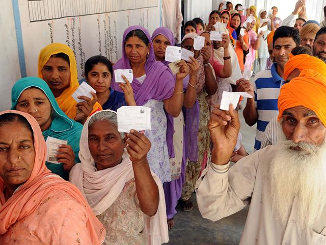 Residents-showing-voter-slips-during-polling-at-Bugra-village-in-Dhuri-on-Saturday-Bharat-Bhushan-HT-Photo