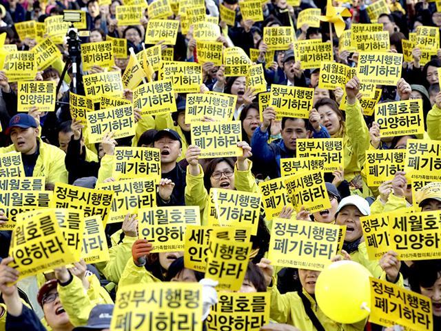 Relatives-of-the-victims-of-a-South-Korean-ferry-sinking-that-killed-more-than-300-people-a-year-ago-and-other-civic-members-shout-slogans-during-a-rally-in-Seoul-AP-Photo
