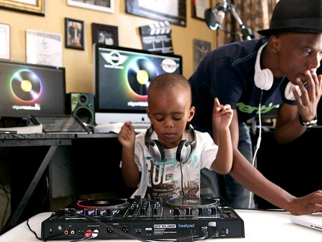 Two-year-old-Oratilwe-Hlongwane-also-known-as-DJ-AJ-to-his-fans-plays-with-the-buttons-and-knobs-of-a-sophisticated-music-system-in-control-of-the-beat-of-the-bass-heavy-house-music-at-his-Alexandra-home-in-Johannesburg-AP-Photo