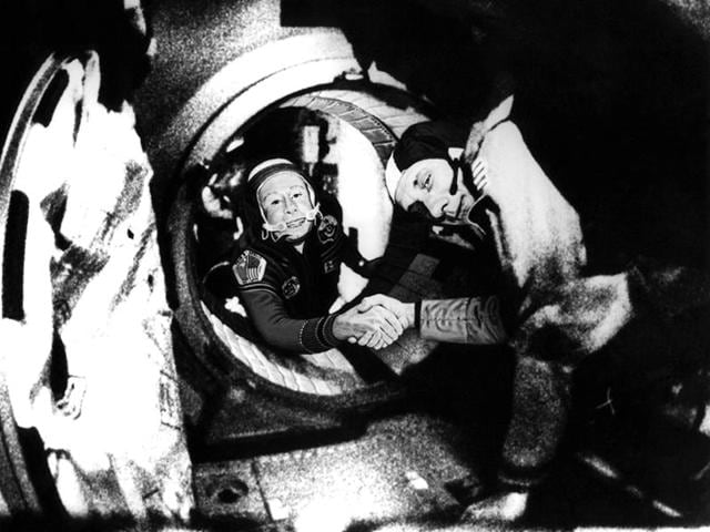 Commander-of-the-Soviet-crew-of-Soyuz-Alexei-Leonov-L-and-commander-of-the-American-crew-of-Apollo-Thomas-Stafford-R-shake-hands-17-July-1975-in-the-space-somewhere-over-Western-Germany-after-the-Apollo-Soyuz-docking-manoeuvres-AFP-Photo