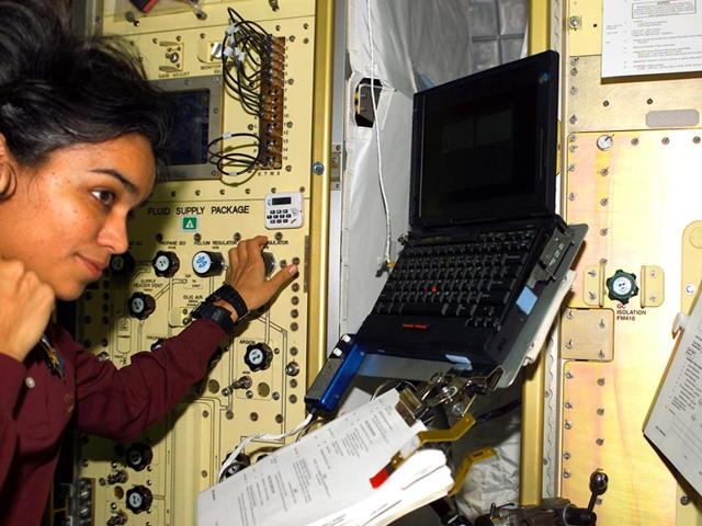 Human-space-flight-day-Taken-on-27-January-2003-Astronaut-Kalpana-Chawla-STS-107-mission-specialist-looks-over-a-procedures-checklist-in-the-SPACEHAB-Research-Double-Module-aboard-the-Space-Shuttle-Columbia-Photo-NASA