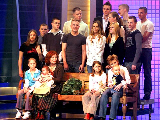 This-file-photo-taken-on-December-11-2005-shows-then-55-old-Annegret-Raunigk-1st-row-2ndL-posing-with-her-youngest-daugher-Lelia-on-her-knees-and-other-children-and-grand-children-in-Cologne-as-guest-in-a-German-channel-show-AFP-Photo