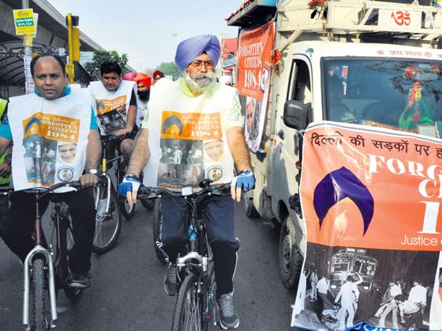 Lawyer-and-AAP-leader-HS-Phoolka-takes-part-in-a-cycle-rally-seeking-justice-for-riot-victims-on-Saturday-Sushil-Kumar-HT-photo