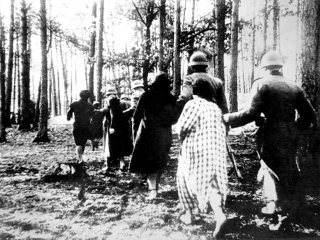 German-atrocities-in-Poland-Polish-women-led-by-soldiers-through-woods-to-their-execution-during-World-War-II-Photo-Shutterstock