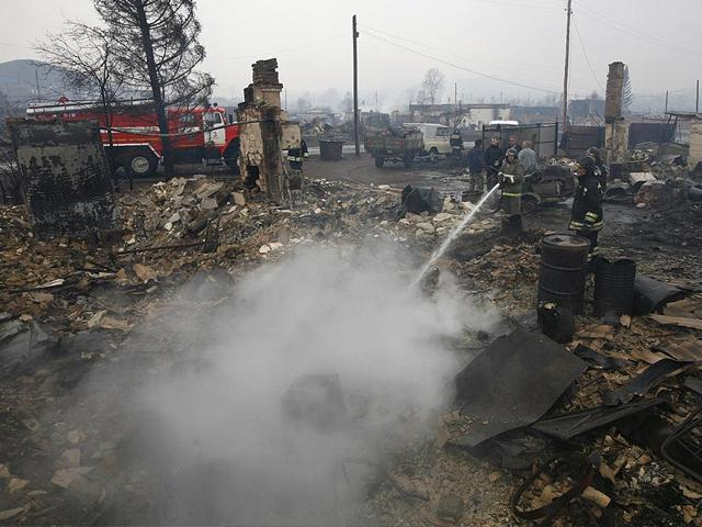 Firefighters-work-amidst-the-debris-of-a-burnt-building-in-the-settlement-of-Shyra-damaged-by-recent-wildfires-in-Khakassia-region-Photo-Reuters