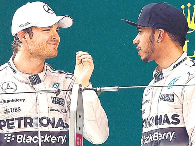 Nico-Rosberg-L-and-Lewis-Hamilton-look-far-from-two-men-driving-for-the-same-team-at-present-AFP-Photo