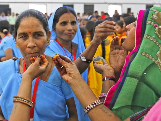 Dalit-women-offer-sweets-at-a-function-to-mark-the-eve-of-the-birth-anniversary-of-BR-Ambedkar-in-New-Delhi-AP-Photo
