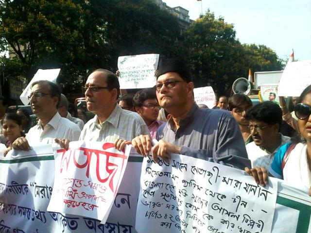 Chandra-Bose-wearing-a-cap-and-Avijit-Roy-to-Bose-s-left-at-a-rally-Joydeep-Thakur-HT-Photo