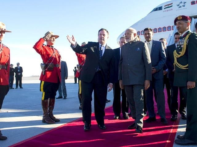 Canadian-minister-of-national-defence-Jason-Kenney-walks-with-Indian-Prime-Minister-Narendra-Modi-as-he-arrives-at-Ottawa-Ontario-for-a-state-visit-on-Tuesday-Justin-Tang-The-Canadian-Press-via-AP
