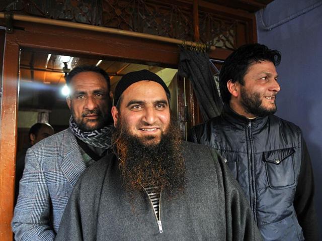 In-this-March-8-2015-photo-senior-Kashmiri-separatist-leader-Masarat-Alam-speaks-on-a-phone-at-his-home-in-Srinagar-AP-Photo