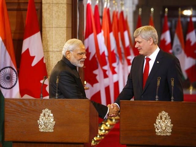 Canada-PM-Stephen-Harper-shakes-hands-with-Prime-Minister-Narendra-Modi-during-a-joint-press-conference-on-Parliament-Hill-in-Ottawa-AFP-Photo