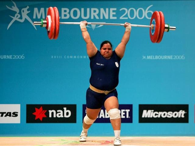 Geeta-Rani-makes-a-sucessful-lift-to-secure-the-gold-medal-in-the-women-s-75kg-weightlifting-at-the-Melbourne-Exhibition-Centre-during-day-seven-of-the-Melbourne-2006-Commonwealth-Games-March-22-2006-in-Melbourne-Australia-Getty