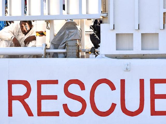 A-wounded-migrant-looks-at-the-shores-as-he-waits-to-disembark-from-Italian-Coast-Guard-ship-Dattilo--in-Augusta-s-port-near-Siracusa-Sicily-Italy-AP-Photo