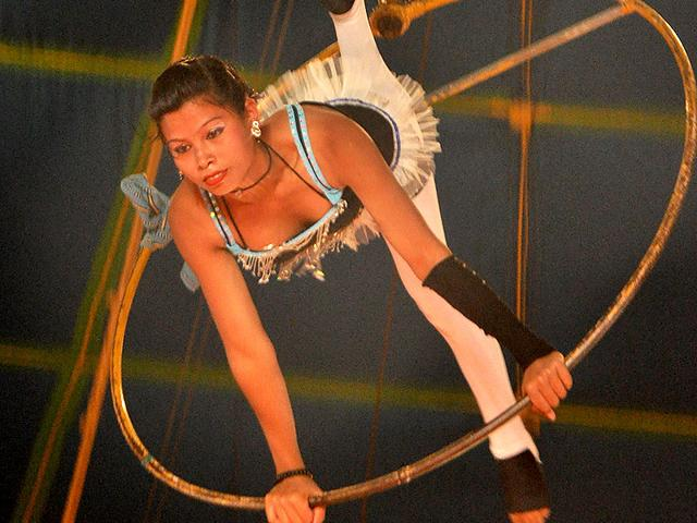 A woman swinging on a trapeze ring. (HT Photo)