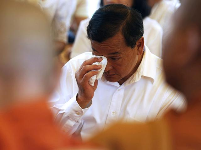 Sam-Rainsy-President-of-the-Cambodia-National-Rescue-Party-CNRP-reacts-during-a-Buddhist-ceremony-at-Choeung-Ek-a-Killing-Fields-site-located-on-the-outskirts-of-Phnom-Penh-REUTERS