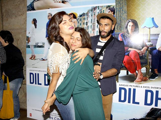 Ranveer Singh looks surprised as Priyanka Chopra hugs filmmaker Zoya Akhtar at a promotional event for Dil Dhadakne Do in Mumbai. (Photo: IANS)