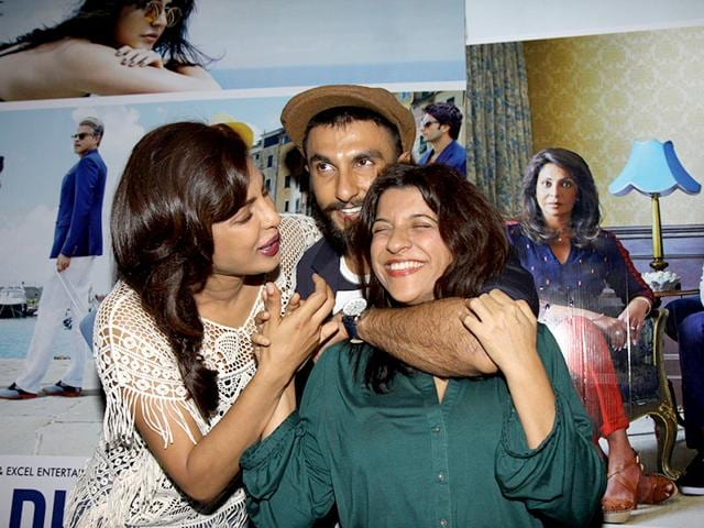 Why is Ranveer Singh strangling filmmaker Zoya Akhtar? The duo shares light moments with Priyanka Chopra at an event of the movie Dil Dhadakne Do. (Photo: IANS)