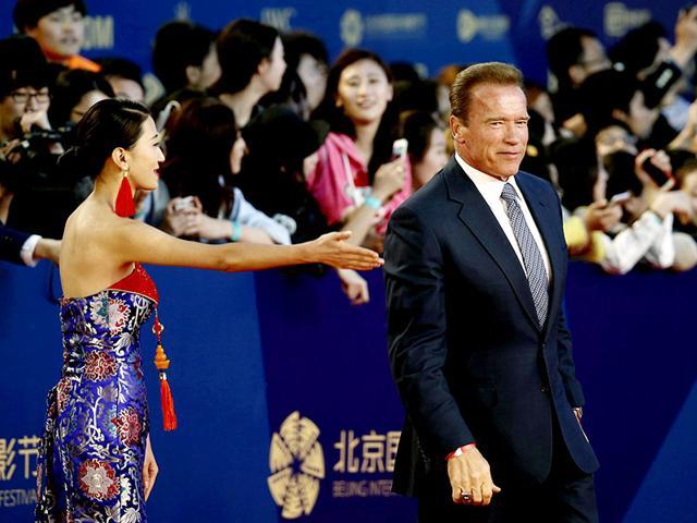 US-actor-Arnold-Schwarzenegger-walks-on-the-red-carpet-at-the-Beijing-International-Film-Festival-April-16-2015-Reuters