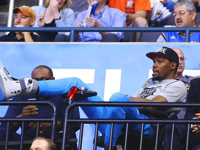 Oklahoma-City-Thunder-forward-Kevin-Durant-props-up-his-injured-foot-as-he-watches-from-the-seating-area-in-the-second-quarter-of-the-game-against-the-San-Antonio-Spurs-in-Oklahoma-City-on-April-7-AP-Photo